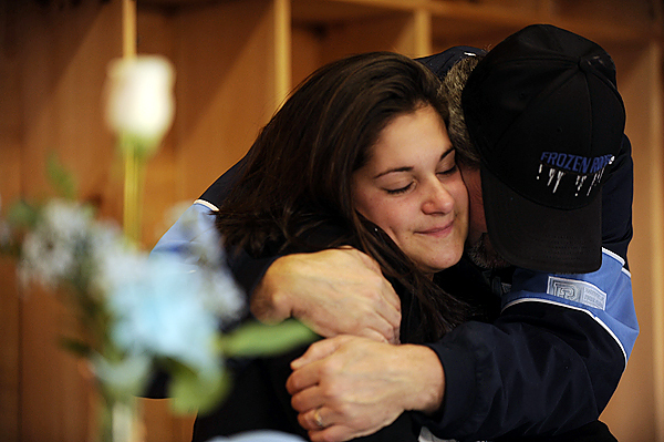 Bangor High School softball pitcher Sam Bedore gets a hug from her dad, Bob Bedore, after signing a National Letter of Intent to play for the University of Rhode Island Rams during Thursday afternoon's press conference at Bangor High School. (Bangor Daily News/John Clarke Russ)