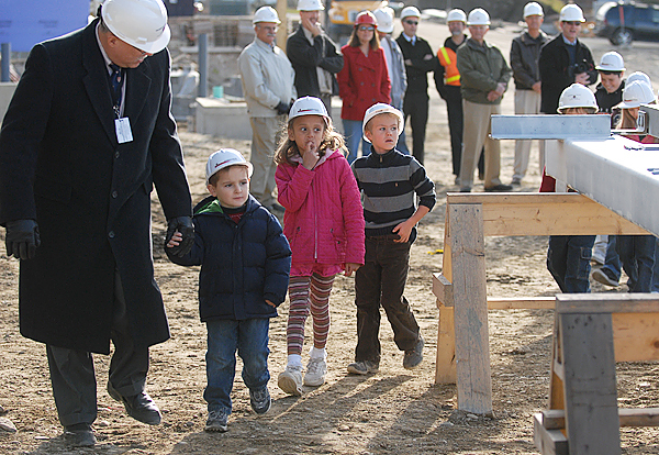Brewer School Superintendent Daniel Lee, left, leads Manuel Ramos, 4, Trea Broussard, 5, Hunter Russell, 7, and other Brewer school students to their signing of last steel beam before it was lifted into place on the future Brewer Elementary-Middle School Campus construction project during Thursday afternoon's ceremony.(Bangor Daily News/John Clarke Russ)