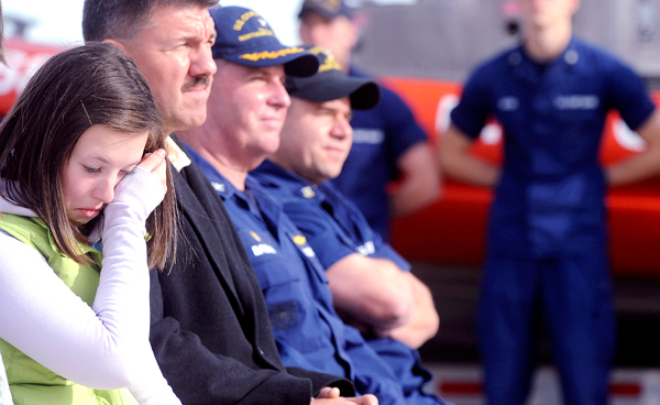 Twelve-year-old Simone Pelletier (left) of Belfast wipes away tears during a ceremony honoring members of the U.S. Coast Guard Friday in Southwest Harbor.  The crews who participated in the rescue of people who were swept into the ocean by storm-driven wavesoff Mount Desert Island in late August received medals from the commandant of the United States Coast Guard Admiral Thad Allen.  Pelletier was one of the seven people who were washed into the ocean and was later rescued by the Coast Guard. BANGOR DAILY NEWS PHOTO BY GABOR DEGRE