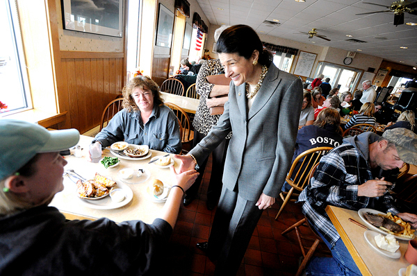 Sen. Olympia J. Snowe shakes hands with Jordan Kiester (lower left), 20 of St. Francis, ME while talking with her, her mother Kelly Kiester of St. Francis, ME and other constituents during Snowe's lunch stop at Dysart's Truck Stop & Restaurant in Hermon Friday, November 13, 2009. Jordan Kiester said she hopes to attend school to become a certified nursing assistant. ( Bangor Daily News/John Clarke Russ)