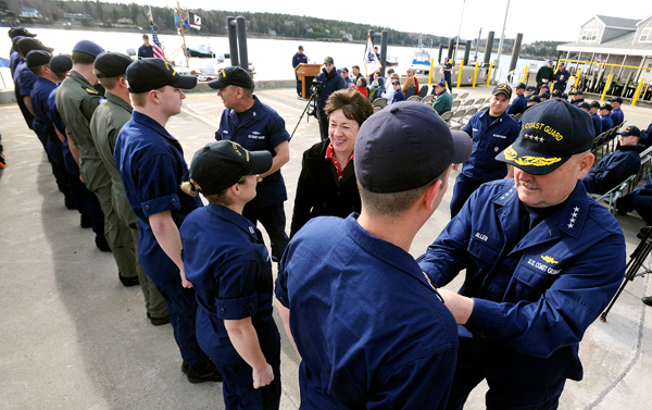 United States Coast Guard Commandant Admiral Thad Allen (right) and U.S. Sen. Susan Collins congratulated the crews of the boats and aircraft who participated in the search and rescue efforts near Thunder Hole on August 23, 2009.  Several members received medals Friday at the Southwest Harbor Coast Guard station. The ceremony honored their efforts in the rescue that saved six of the victims and recovered the seventh person who were all washed off the rocks by large storm waves off Mount Desert Island. BANGOR DAILY NEWS PHOTO BY GABOR DEGRE