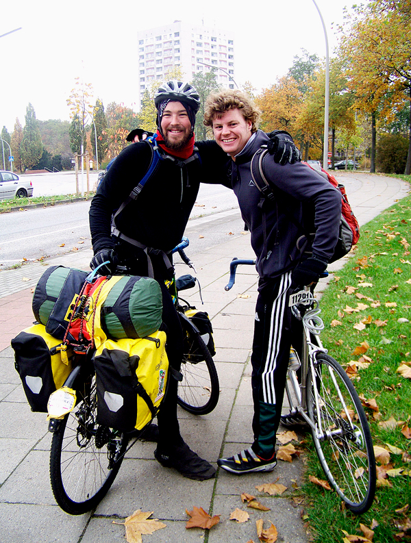 Old friends Ellery Alhaus (left) and Arne Gloe (right) say goodbye after Gloe led the cyclists out of Hamburg on bicycle.  LEVI BRIDGES PHOTO