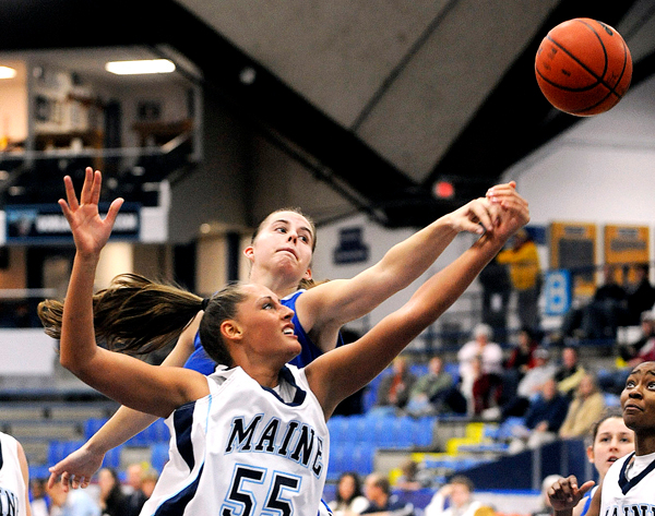 The University of Maine's Katia Bratishko (55) battles for the rebound with Central Connecticut's Leanne Crockett during the first half of the game in Orono Friday evening.  BANGOR DAILY NEWS PHOTO BY GABOR DEGRE