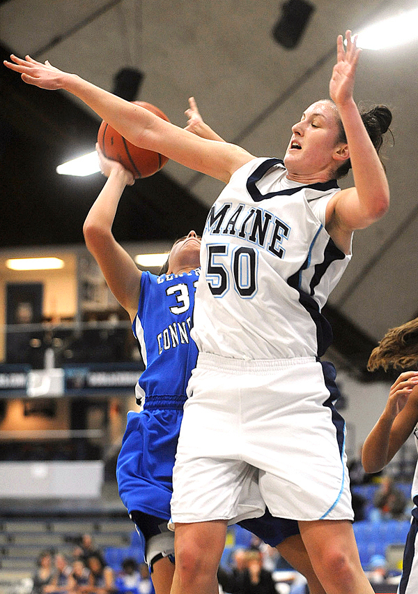 The University of Maine's Samantha Baranowski (50) fouls Central Connecticut's Kerrianne Dugan as she blocks a shot during the first half of the game in Orono Friday evening.  BANGOR DAILY NEWS PHOTO BY GABOR DEGRE