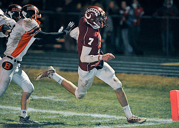 Bangor's Joe Seccareccia, (7), outruns Brunswick defenders John Imbriano, (15), and Max Roberts, (3),  into the end zone for a score in the first half of their game in Bangor, Friday, Nov. 13, 2009. Bangor Daily NEws/Michael C. York
