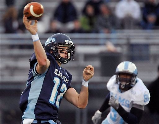 Maine quarterback Chris Treister (12) fires a pass under pressure from Rhode Island's Matt Raye (97) during the second half of an NCAA football game in Orono, Maine, Saturday, Nov. 14, 2009. (AP Photo/Michael C. York)