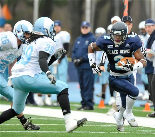 Maine's Landis Williams, right,  races down the sidelines under pressure from Rhode Island's Daniel O'Connell (25) and Ellis Foster (39) during the first half of an NCAA football game in Orono, Maine, Saturday, Nov. 14, 2009. (AP Photo/Michael C. York)