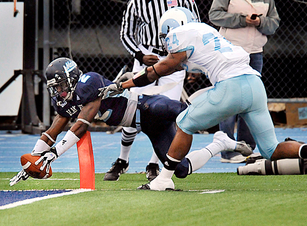 Maine's Landis Williams, (2) tucks the ball inside the goal line for a touchdown before Rhode Island's Jarrod Williams, (24), can push him out of bounds in the second half of their NCAA football game in Orono, Maine, Saturday, Nov. 14, 2009. AP PHOTO BY MICHAEL YORK