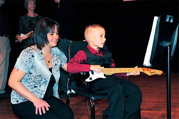 Devin White takes a few moments to review his music with his mother Jessie White following his sound check for the third annual Kounty Kids Got Talent show Sunday afternoon in Caribou. Devin soloed on the electric guitar playing Beethoven's Ode to Joy. BANGOR DAILY NEWS PHOTO BY JULIA BAYLY