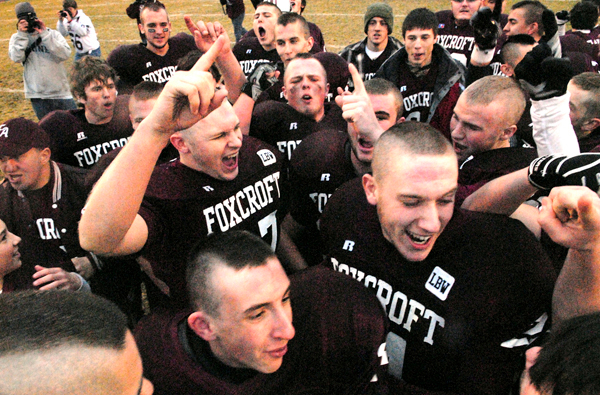The Foxcroft Academy Ponies celebrate their Eastern Maine Class C title in Dover-Foxcroft Saturday afternoon, November 14, 2009. They edged John Bapst Memorial High School 14-13. BANGOR DAILY NEWS PHOTO BY JOHN CLARKE RUSS