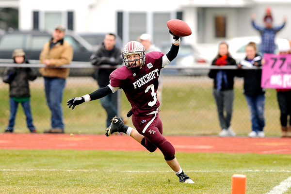 Foxcroft Academy wide receiver Josiah Richard scores the team's second touchdown at the beginning of the second quarter of their Eastern Maine Class C final in Dover-Foxcroft Saturday afternoon, November 14, 2009. BANGOR DAILY NEWS PHOTO BY JOHN CLARKE RUSS
