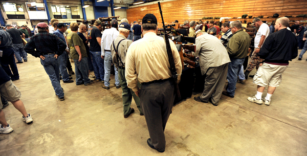 Most vendors tables at the Bangor Gun Show had gun enthusiast  2-3 deep waiting to see new or used guns or accessories being offered for sale or trade during the 2009 Bangor Gun Show at the Bangor Auditorium on Saturday, September 12, 2009. BANGOR DAILY NEWS PHOTO BY KEVIN BENNETT