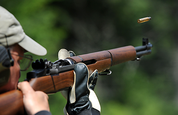 A shell casing flies out of a competitor's M-1 rifle during an annual marksmenship competition at the Hermon Rifle Club shooting range on July 12th 2009.  The participants shoot from several distances ranging from 200 to 600 yards using M-1 rifles designed by John C. Garand and modern semiatomatic rifles that are customized for competition use. (bangor Daily News/Gabor Degre)