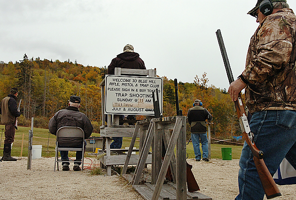(BANGOR DAILY NEWS PHOTO BY BRIDGET BROWN)  CAPTION  Blue Hill Rifle & Pistol Club members participate in trap shooting at the club's annual Fall Shoot and Open House on Sunday, Oct. 18, 2009. The club hosts trap shooting sessions every Sunday and shooters get 25 shots, five at each of the five shooting positions to hit the flying traps. (Bangor Daily News/Bridget Brown)  HOLD FOR POSSIBLE USE IN GUNS IN MAINE SERIES