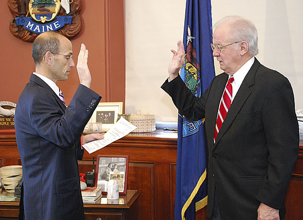 Gov. John E. Baldacci swears in Thaxter Trafton as the acting Commissioner of the Department of Economic and Community Development Monday, November 16, 2009. (Photo courtesy of Governor's Office)