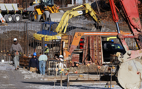 Crews work on the senior housing project in Bangor.  Volunteers of America Northern New England is builiding the 55-unit affordable housing community in the downtown area.  The opening is expected in early 2011. (Bangor Daily News/Gabor Degre)