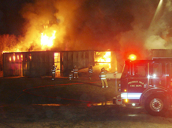 The Presque Isle Fire Department responded to a reported warehouse fire on Rice Street at 9:52 p.m. Friday. The warehouse, which stored large rolls of paper and polyurethane for printing, also contained drums of ink, solvents and a large propane tank. There were no injuries or deaths.   PHOTO COURTESY OF THE PRESQUE ISLE FIRE DEPARTMENT