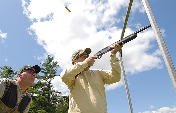 Instructor Brian Porter,left, of Holden watches a participant shoot a clay at the Hermon Skeet Club on Saturday, August 8, 2009. The Penobscot County Conservation Association, in conjunction with a grant from the National Rifle Association, sponsored the event at the Hermon Skeet Club and the Hampden Rifle and Pistol Club that Saturday to promote firearm safety and sportsmanship. (Bangor Daily News/John Clarke Russ)