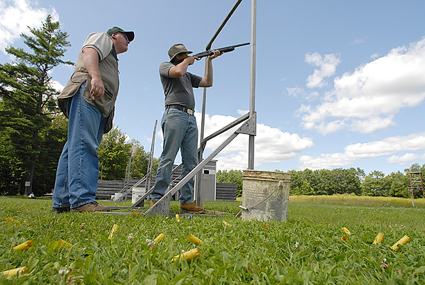 Instructor Brian Porter,left, of Holden watches a participant take aim at clays at the Hermon Skeet Club on Saturday, August 8, 2009. The Penobscot County Conservation Association, in conjunction with a grant from the National Rifle Association, sponsored the event at the Hermon Skeet Club and the Hampden Rifle and Pistol Club that Saturday to promote firearm safety and sportsmanship. (Bangor Daily News/John Clarke Russ)