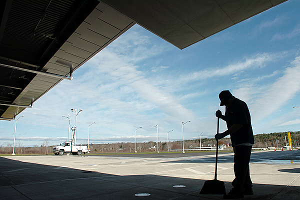Burr Brakeman of Acclaim Quality Services sweeps near the lobby entrance of the new Calais border crossing on Monday, Nov. 16, 2009. Both the U.S. and St. Stephen, Canada sides of the crossing opened Monday morning.  Commercial vehicles will now be required to use the new crossing, which took just more than a year and a half and $125 million to complete. (Bangor Daily News/Bridget Brown)