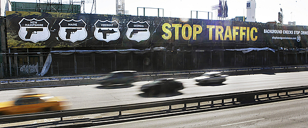 Cars on the Massachusetts Turnpike pass a new billboard  in Boston which reads &quotStop Traffic - Background Checks Stop Crime&quot with four guns pictured underneath the names of four states: New Hampshire, Maine, Vermont and Georgia. John Rosenthal, the owner of the billboard and the founder of Stop Handgun Violence, says lax laws in those states promote gun trafficking into Massachusetts. (AP Photo/Elise Amendola)