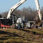 Crews remove soil from contaminated crash site