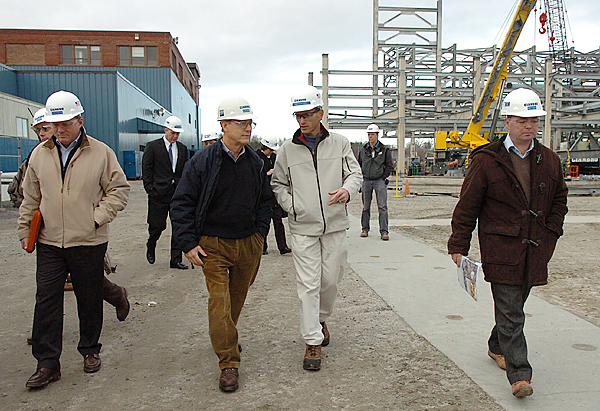Cianbro CEO Peter Vigue (left of center) and Governor John Baldacci (right of center) talk while leading a tour of their Brewer facility to Statoil's technical manager Knut Erik Steen (right), and asset manager Sjur Bratland (not pictured) on Tuesday, Nov. 17, 2009. The Norway-based company developed the world's first floating turbine and Maine officials are hoping to partner with them to help develop off-shore wind energy in Maine. (Bangor Daily News/Bridget Brown)