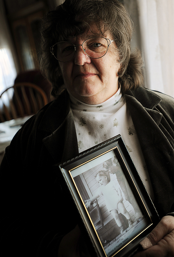 Dorothy Holmes Brown poses with a picture of her brother, Fredrick Holmes, on Tuesday, November 17, 2009 at her Milo home. Holmes was a 22-month-old toddler when he disappeared from the family's home in the Catskill mountains of New York in 1955. Brown has recently donated DNA to help in locating her long-lost brother. (Bangor Daily News/Kevin Bennett)