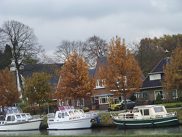 A typical Dutch canal. Holland is a very low-lying country near the sea with an intricate system of canals slicing across it. Many towns are connected by roads, bike paths and canals. One can travel throughout the country easily by almost any form of transportation. (Photo courtesy of Levi Bridges)