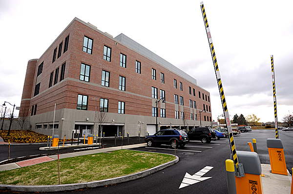 Rear view of the soon-to-open Penobscot Judicial Center in downtown Bangor. On the right is a security-gated parking lot that abuts the Kenduskeag Stream. Photographed Friday morning, November 6, 2009. BANGOR DAILY NEWS PHOTO BY JOHN CLARKE RUSS