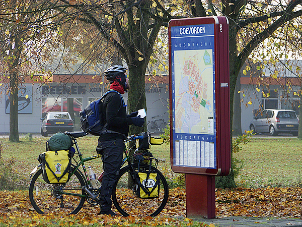 Dutch bike paths are marked with signs that tell riders where they are headed. But the paths are so numerous that one can still easily become lost. Ellery Althaus (pictured above) consults one of many maps by the roadside along the way. (Photo courtesy of Levi Bridges)