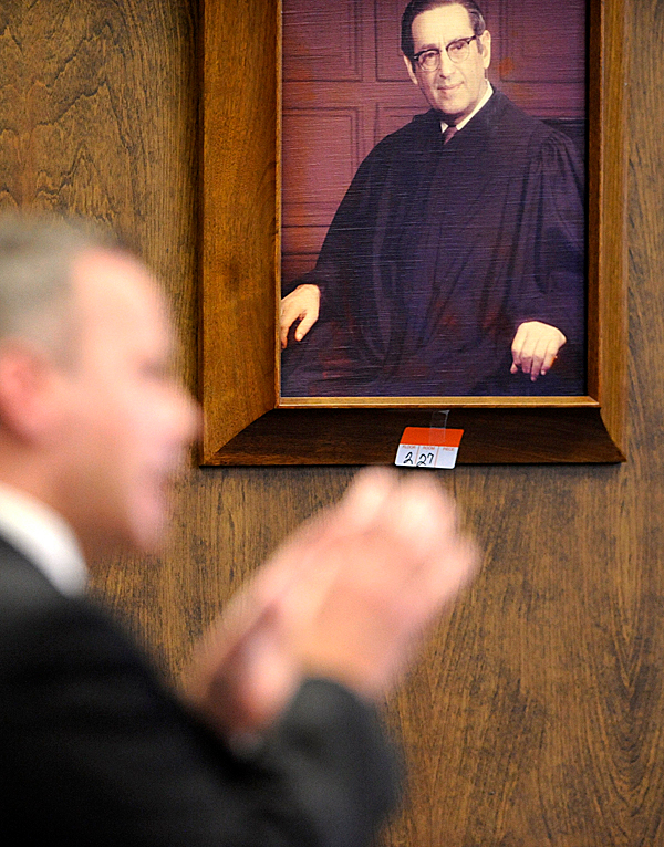 A moving label is affixed  of several judge portraits which will be transferred from Penobscot Superior Court to the soon-to-open Penobscot Judicial Center. In the foreground Bangor defense attorney F. David Walker IV addresses the judge during Stephen James' sentencing hearing Friday, November 13, 2009. BANGOR DAILY NEWS PHOTO BY JOHN CLARKE RUSS