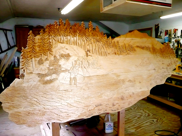 Eddie Harrow's piece created for the Penobscot Jucdicial Center.  The bas relief panel, made of basswood (also known as limewood), is two inches thick and  roughly 4 feet high x 8 feet wide.    PHOTO COURTESY OF EDDIE HARROW