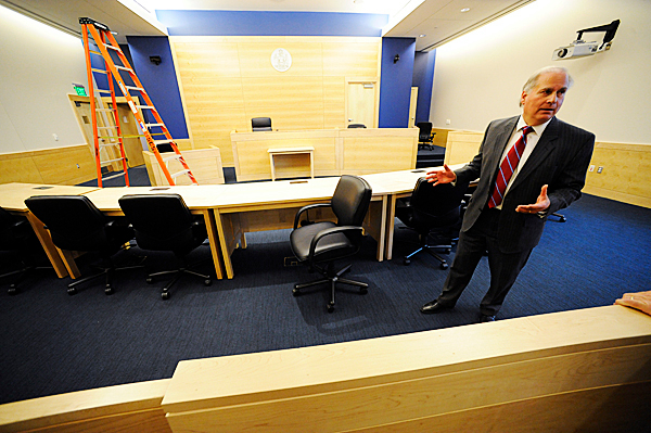 Justice Warren Silver shows off one of seven courtrooms in the soon-to-open Penobscot Judicial Center in downtown Bangor. Photographed while Justice Silver and Justice Andrew Mead gave the Bangor Daily News a tour of the new facility Friday morning, November 6, 2009. BANGOR DAILY NEWS PHOTO BY JOHN CLARKE RUSS