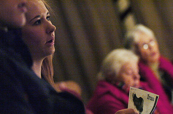 Katie Hill (L) of Orrington, a congregant at the Second Congregational Church in South Brewer, listens as Rev. Scott Cleveland talks about meeting in secret due to persecution. Fourteen people met in the basement of the church, role playing as if they were attempting to worship in modern day Iran.(Bangor Daily News/Kevin Bennett)