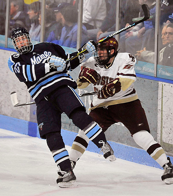 Boston College's Patrick Wey, (6), gives a shove to Maine's Will O'Neill, (27), in the first period of their game in Orono, Maine, Friday, Nov. 20, 2009. Bangor Daily News/Michael C. York