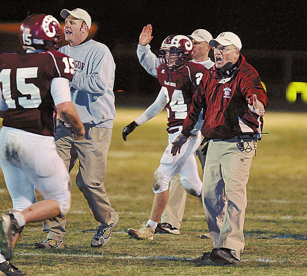 Bangor coach Mark Hackett congratulates his players as they come off the field during the Brunswick game , Nov. 13, 2009. Bangor Daily News/Michael C. York