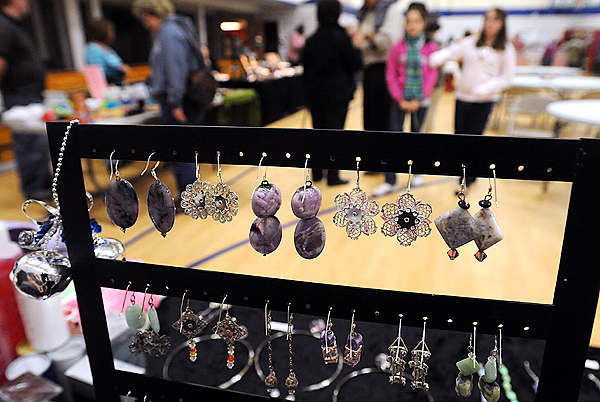 People walk around at the Craft Fair at the Bangor Christian High School Saturday.  The fair strted this year will benefit the Boosters Club and featured 20 vendors.  In the foreground are ear rings made by Carmen Mosher of Smithfield. (bangor daily News/Gabor Degre)