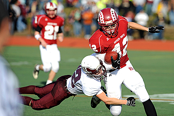 Bangor High School wide receiver Josiah Hartley is slowed by Windham High School's Nick Burton in the fourth quarter of their Class A State Football Championship at Fitzpatrick Stadium in Portland Saturday, November 21, 2009. The Windham High School Eagles won 35-21. (Bangor Daily News/ John Clarke Russ)