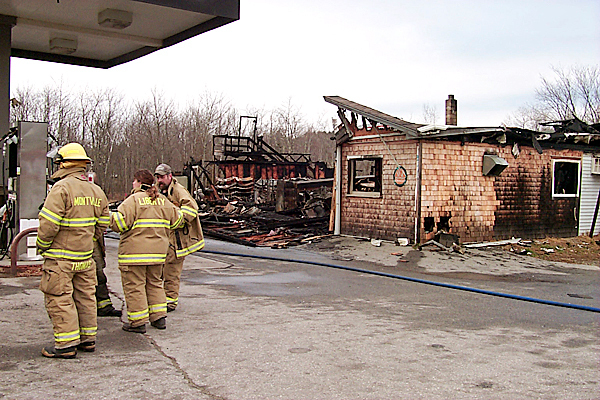 Fire destroyed the Liberty Trading Post on Route 3 Sunday night. Fire fighters from 10 towns responded to the alarm and took more than three hours to contain the fire. Along with selliong groceries and hardware, the store was the only place in town to gas up the car. BANGOR DAILY NEWS PHOTO BY WALTER GRIFFIN
