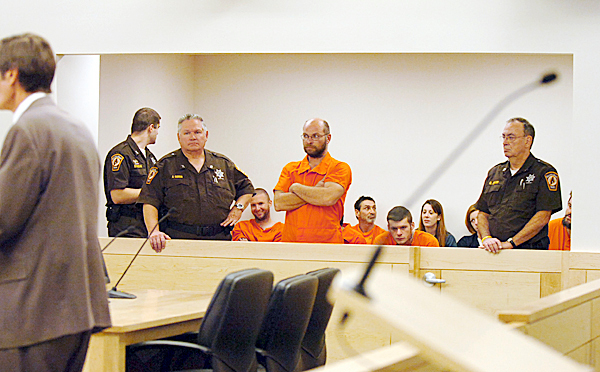 Douglas Deloge, 39, of Medway (center) made his first appearance before Judge Jessie Gunther on Monday, Nov. 23, 2009 at the Penobscot Judicial Center on the first day the center was open for business. Deloge is charged with setting fire last week to an abandoned house.