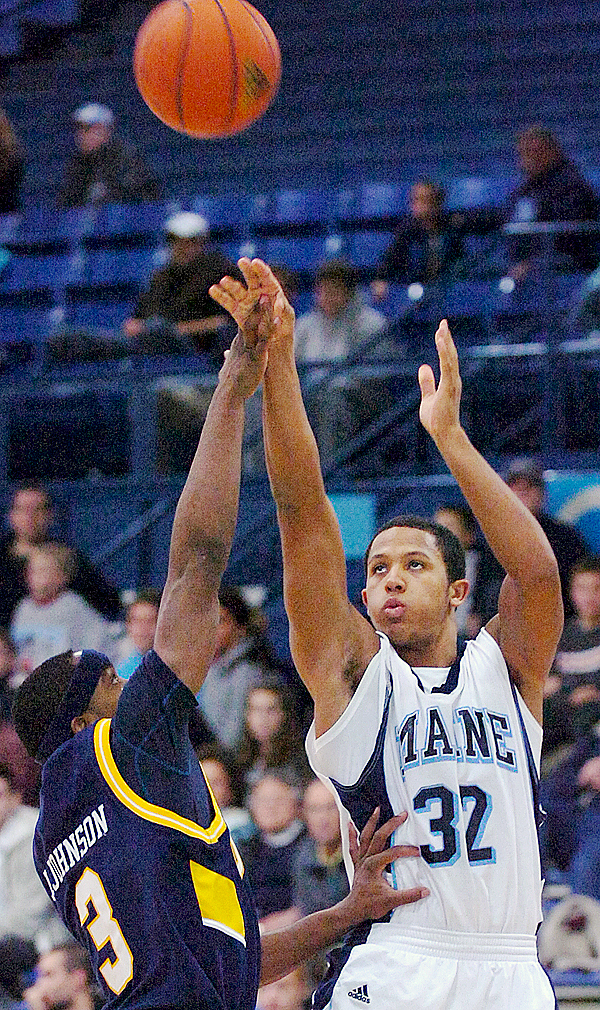 The University of Maine's Gerald McLemore (32) goes up for a shot against Quinnipiac University's James Johnson (3), in the second half of Tuesday's game, Nov. 24, 2009 at the Alfond Arena in Orono. (Bangor Daily News/Bridget Brown)