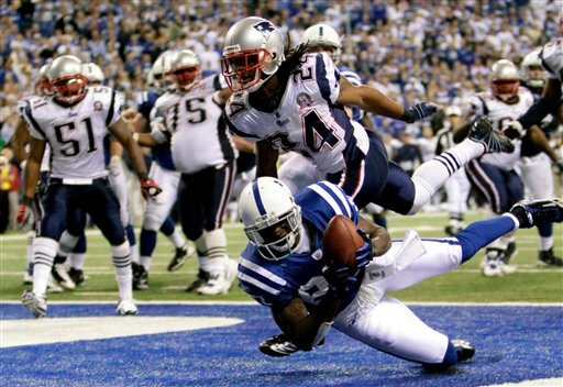 Indianapolis Colts wide receiver Reggie Wayne (87) makes a touchdown reception during the fourth quarter of an NFL football game against New England Patriots early Monday, Nov. 16, 2009 in Indianapolis. Colts beat the Patriots 35-34. (AP Photo/AJ Mast)