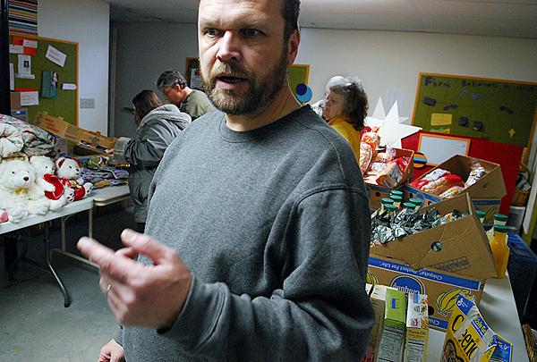Isaac Mann is the director of Seeds of Hope Food Pantry, which operates in the basement of Beacon of Hope Church of God on Ohio Street in Bangor. The pantry, which is open from 10 a.m. to 3 p.m. the first and third Thursdays of every month, has expanded in the past year to meet increased demand by area residents in need.  (BANGOR DAILY NEWS PHOTO BY JOHN CLARKE RUSS)  CAPTION  Isaac Mann is the director of of Seeds of Hope Food Pantry which opereates in the basement of Beacon of Hope Church of God on Ohio Street in Bangor. The pantry, which is open the first and third Thursday of very month from 10am to 3pm, has expanded in the past year to meet increased demand by area residents in need. Photographed Thursday afternoon, January 3, 2008. (John Clarke Russ, Bangor Daily News)