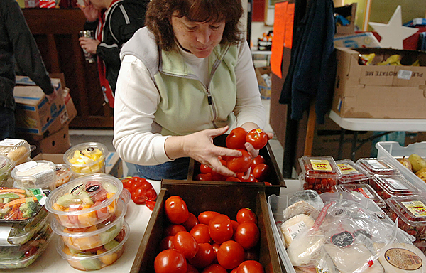 (BANGOR DAILY NEWS PHOTO BY BRIDGET BROWN)  CAPTION  Volunteer Barbara Frederick of Orono sorts through produce at the Seeds of Hope Food Pantry in Bangor on Thursday, Nov. 19, 2009. (Bangor Daily News/Bridget Brown)