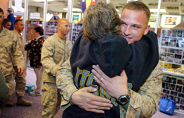 Rhonda Sperrey of Washburn embraces her nephew Cpl. Richard Korhonen, who returned to the U.S. with fellow marines from the 2nd Light Armored Reconnaissance Charlie Company, at Bangor International Airport on Thursday, Nov. 26, 2009. The more than 240 soldiers were returning to Cherry Point, N.C. after a tour of duty in Afghanistan. (Bangor Daily News/Bridget Brown)