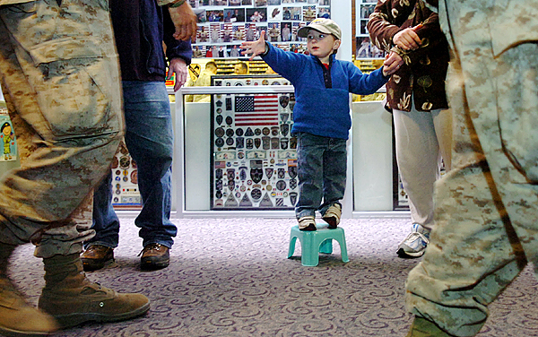 Jonah Bean, 3, of Dedham, along with his parents John and Diana Bean, spent some of his Thanksgiving greeting marines from the 2nd Light Armored Reconnaissance Charlie Company at Bangor International Airport who returned from Afghanistan on Thursday, Nov. 26, 2009. (Bangor Daily News/Bridget Brown)