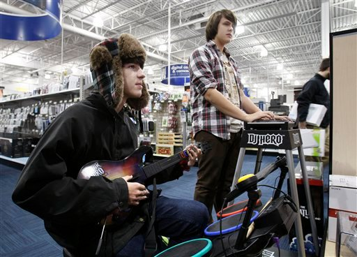 Tyler Graffam, left, and Austin West, of Falmouth, Maine, play the DJ Hero video game at Best Buy on Black Friday, Nov. 27, 2009, in South Portland , Maine. (AP Photo/Robert F. Bukaty)