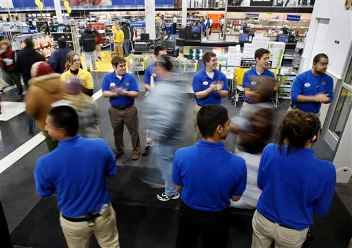 Workers greet the first rush of holiday shoppers at 5 A.M. at Best Buy on Black Friday, Nov. 27, 2009, in South Portland , Maine. (AP Photo/Robert F. Bukaty)