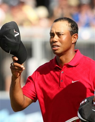 Police: Woods at fault in crash, will get citation